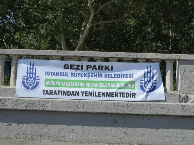 This sign in Taksim Square says, ''Gezi Park is being renovated by the Parks and Recreation Department of the Municipal Government of Istanbul.''