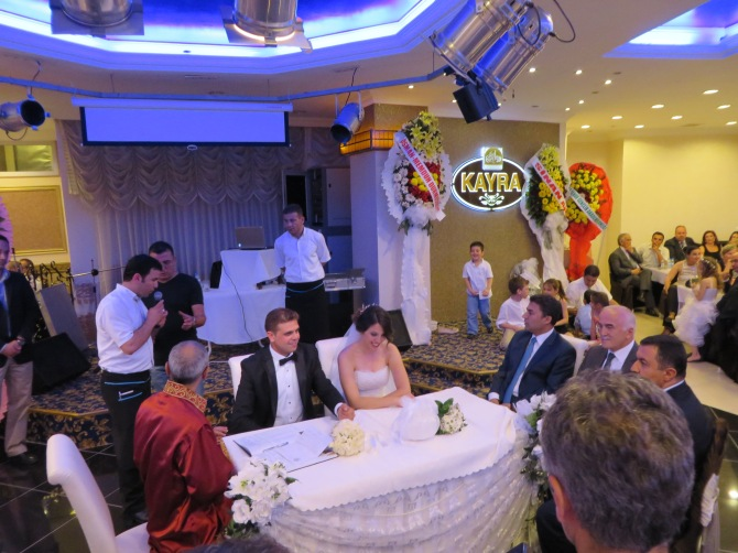 A government officer who works for the mayor of Ankara (in the red) came to join the wedding ceremony