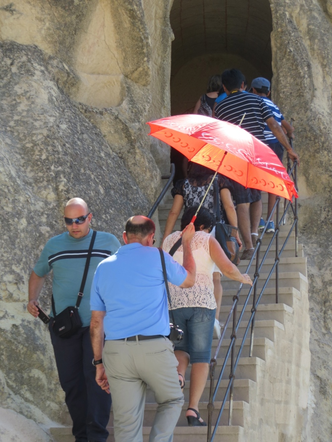 Thought this was the sweetest thing...the man in the blue shirt gave me a sheepish look when he saw me watching him holding the red umbrella over his wife to keep her cool in the hot weather (it was about 100 degrees). So sweet!