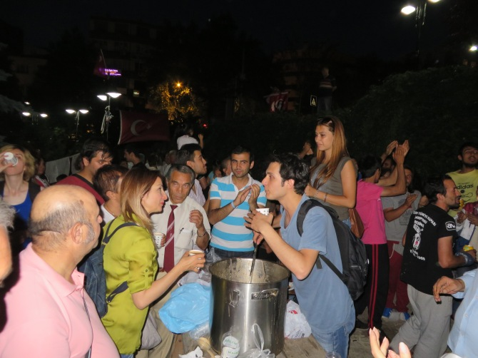 People giving out soup to others for Iftar