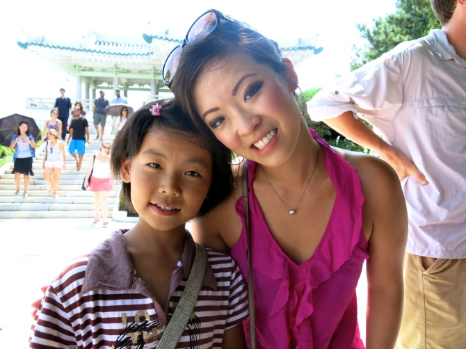 Me and a little girl I met in Wonsan. She called me, 'dong-ji,' which means 'comrade' in Korean. In South Korea, a girl her age would have called me 'unie,' which means older sister.