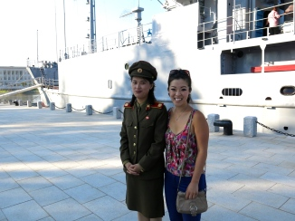 Me and a North Korean military woman officer in front of the USS Pueblo