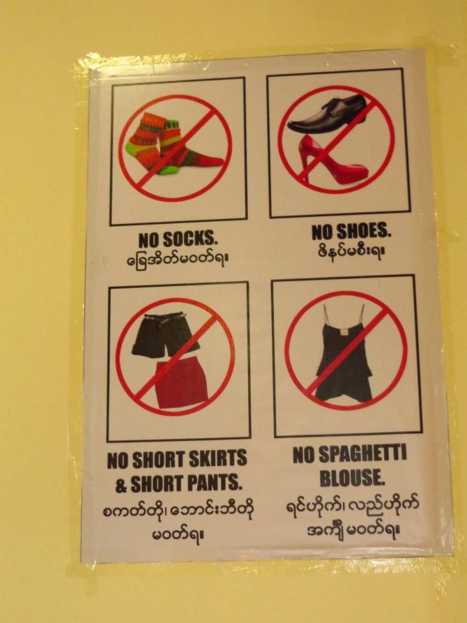 Signage before entering the Shwedagon Pagoda in Yangon