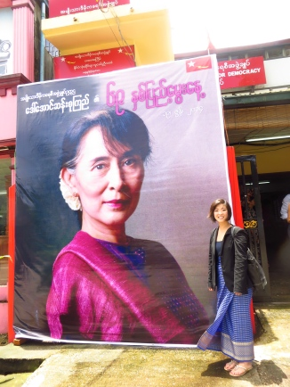 Me and a larger-than-life banner of Aung San Suu Kyi in front of the headquarter office of the National League for Democracy