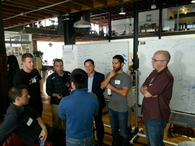 Mr. Kim speaking with one of the hackathon teams on Day 1 of the hackathon